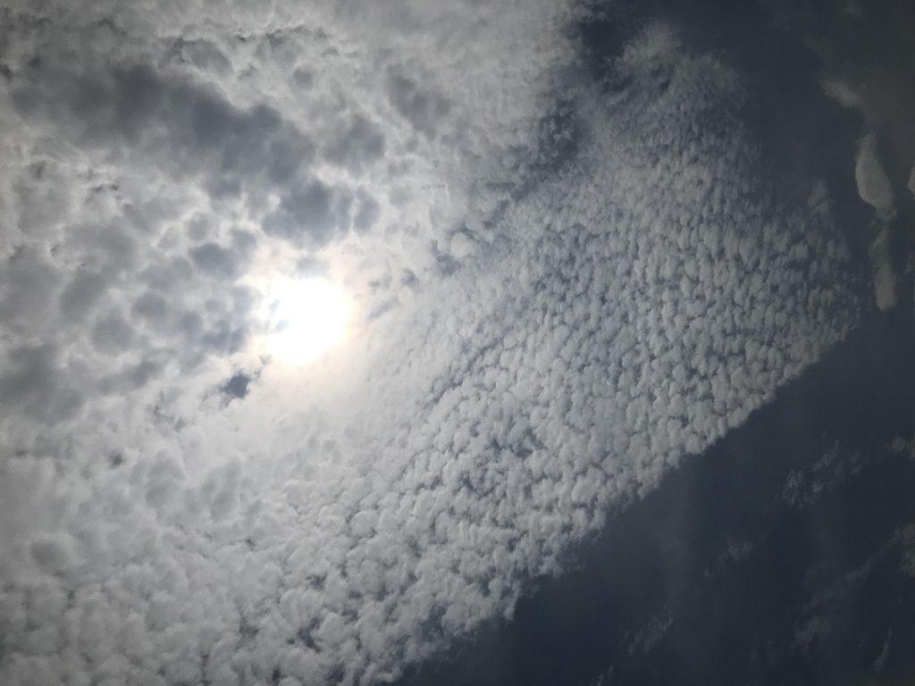 hazy sun pokes through clouds